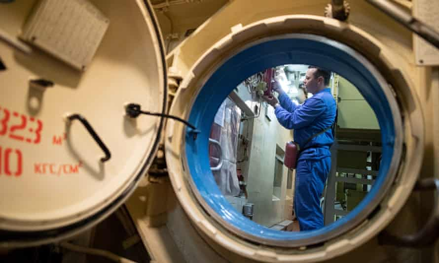 A Russian navy official works on the Akula nuclear-powered ballistic missile submarine at the Severodvinsk site in July. The August explosion there killed at least five people.
