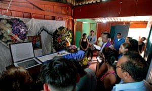 Relatives pray during the wake of 19-year-old student Chester Chavarria, who was shot dead during anti-government protests at the Unan in Managua last week.