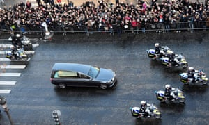 Hallyday's coffin is driven down the Champs-Élysées