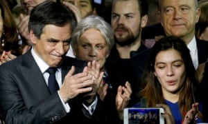 François Fillon (left) with his wife Penelope (second left) and Alain Juppe (top right) at a political rally in Paris on 29 January.