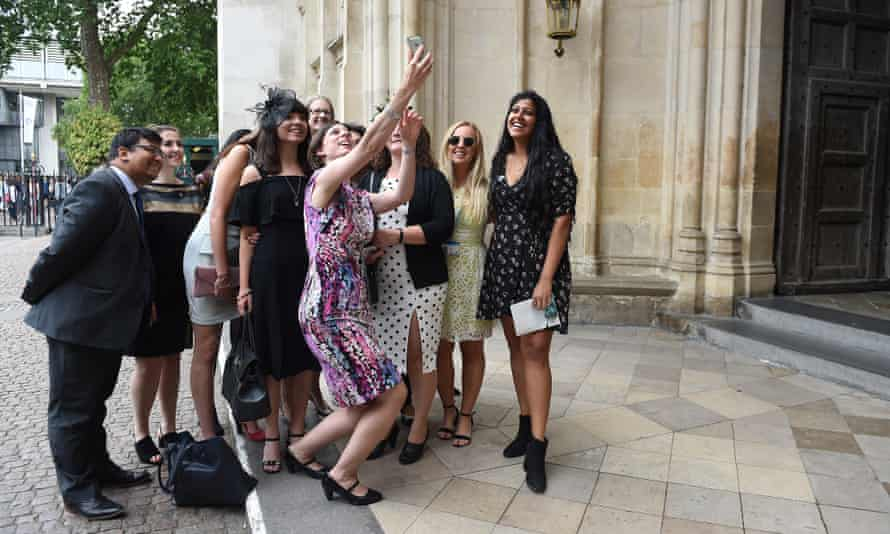 NHS staff pose for a selfie on their arrival at Westminster Abbey