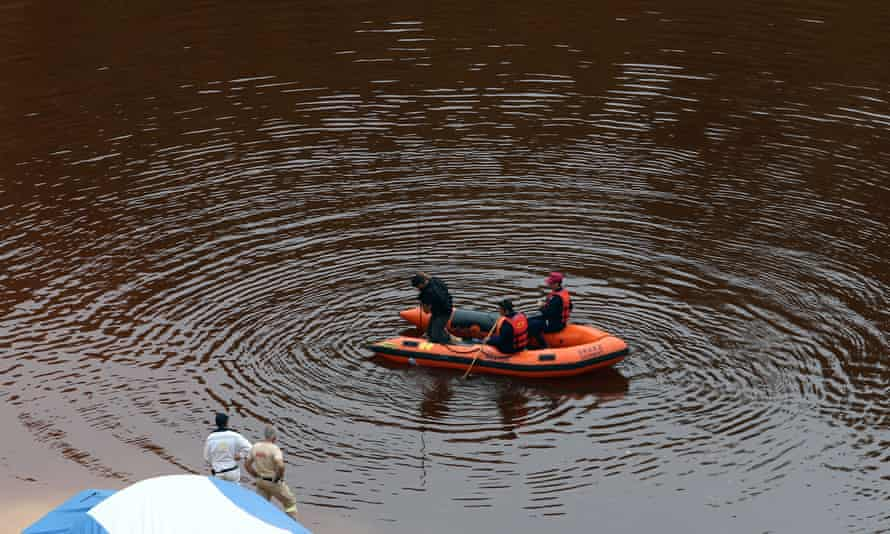Officers search a lake for bodies near the village of Mitsero.