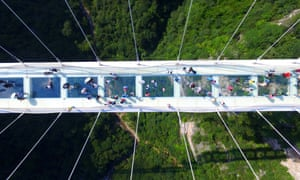 Aerial view photo shows tourists visiting on the glass-bottom bridge at Zhangjiajie Grand Canyon.
