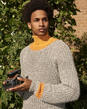 Model wears oatmeal Stevie jumper over yellow polo neck.