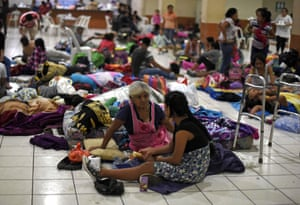 Residents gather in a temporary shelter in Escuintla