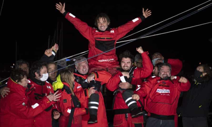 Frenchman Yannick Bestaven celebrates after winning the Vendée Globe solo round-the-world sailing race.