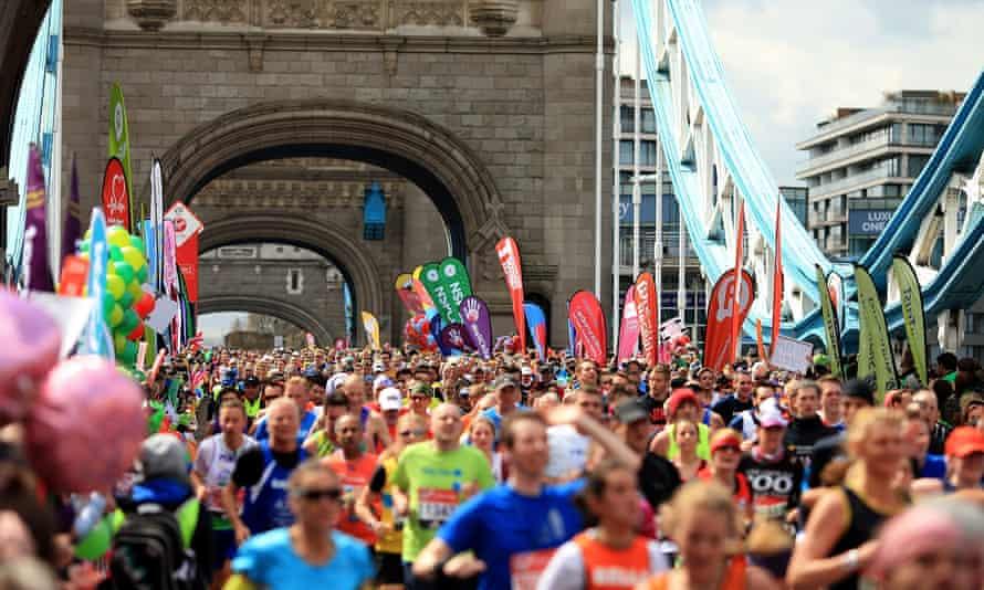 Runners make their way across Tower Bridge during the London Marathon.