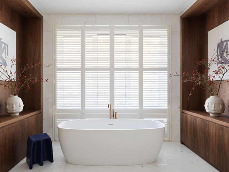 The practical and luxurious master bathroom, with a tub to convert bath-haters.