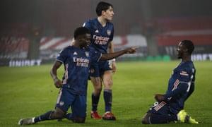 Arsenal's Bukayo Saka (L) celebrates scoring.