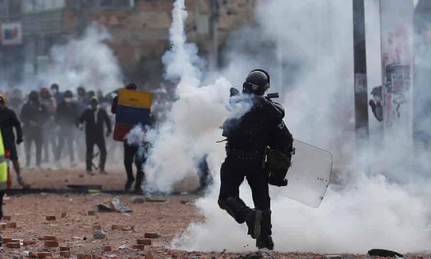 Protesters and members of the anti-riot Squad clash during demonstrations, in Madrid, a municipality near Bogota, Colombia.
