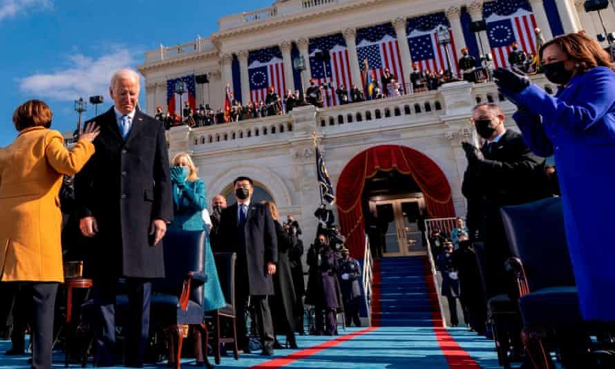 President Joe Biden is sworn in at the US Capitol in Washington DC, with vice-president Kamala Harris watching on.
