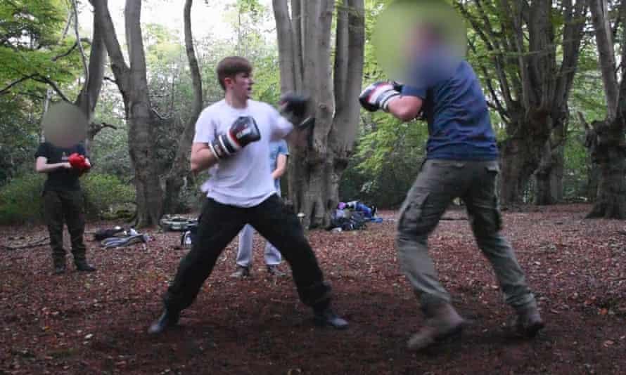 Ben Hannam attending an outdoor boxing event.