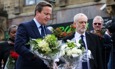 Prime minister David Cameron and Labour leader Jeremy Corbyn lay flowers at the scene where Jo Cox died.