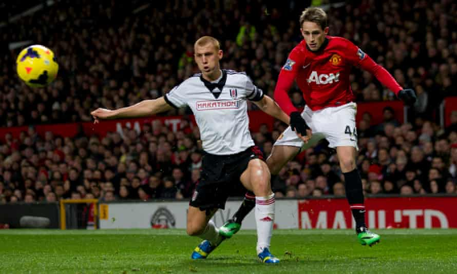 Sidwell with Manchester United's Adnan Januzaj at Old Trafford in 2014 during his stint with Fulham.