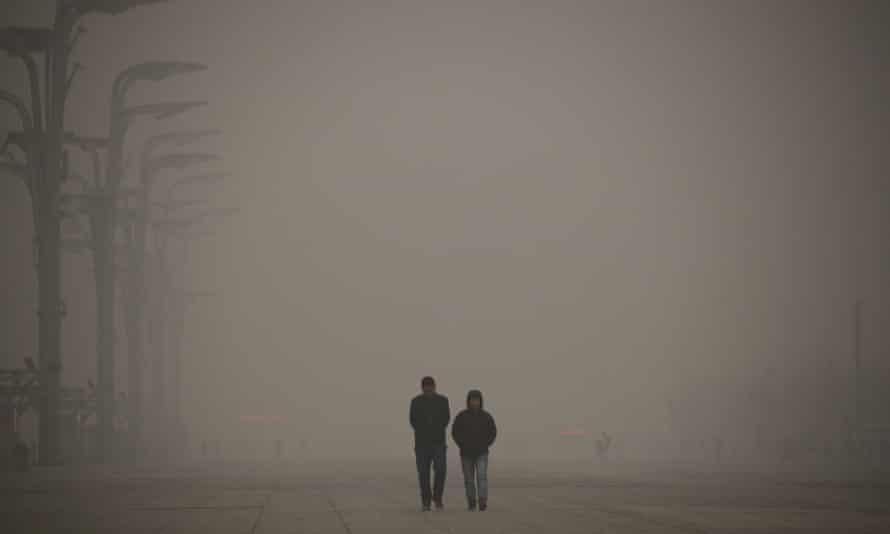 Visitors walk outside the National Stadium in Beijing<br>on 1 December 2015.
