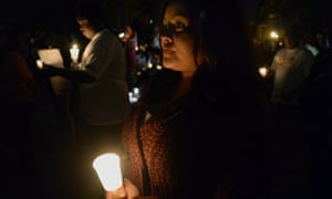 San Bernardino mass shooting memorial<br>epaselect epa05058889 Marisol Molina pays her respects to the shooting victims during a candlelight vigil in downtown San Bernardino, California, USA, 07 December 2015. Husband and wife Syed Farook and Tashfeen Malik carried out the 02 December shooting in San Bernardino, in which 14 people were killed and 21 wounded. EPA/MIKE NELSON