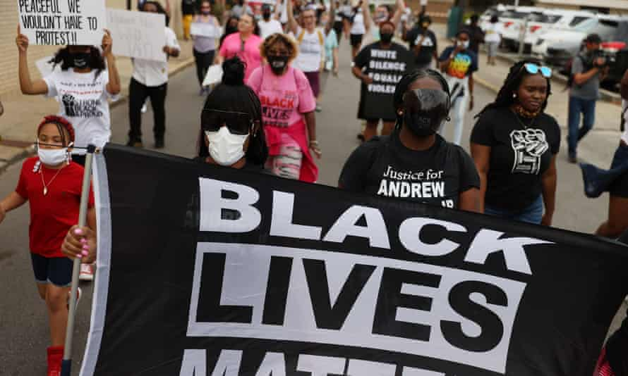 Protesters calling for justice for Andrew Brown Jr march on 29 April 2021 in Elizabeth City, North Carolina.