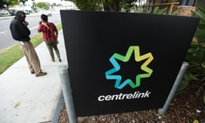 People stand outside a Centrelink office
