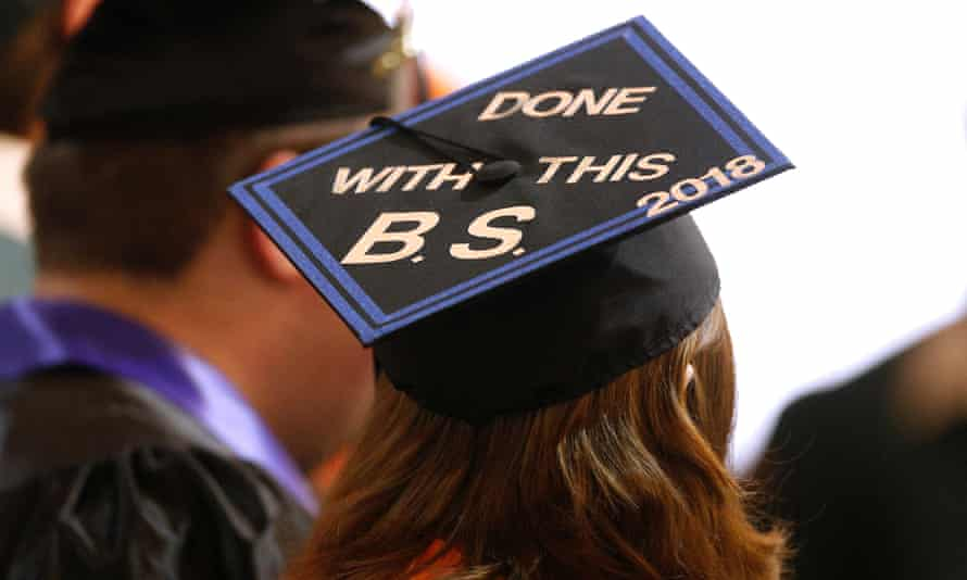 A graduating senior's cap from Alvin high school is seen during prayer services in Santa Fe, Texas on 20 May.