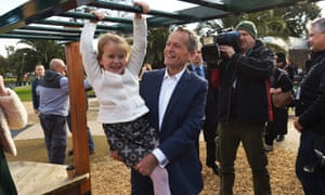 Bill Shorten and daughter Clementine on a play set after a press conference in Moonee Ponds in Melbourne.