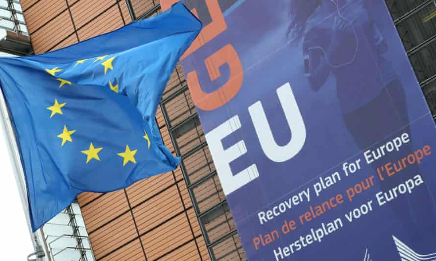 A flag flutters outside the European commission headquarters in Brussels