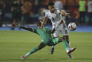 Senegal's Idrissa Gana Gueye and Algeria's Mohamed Belaili fight for the ball.
