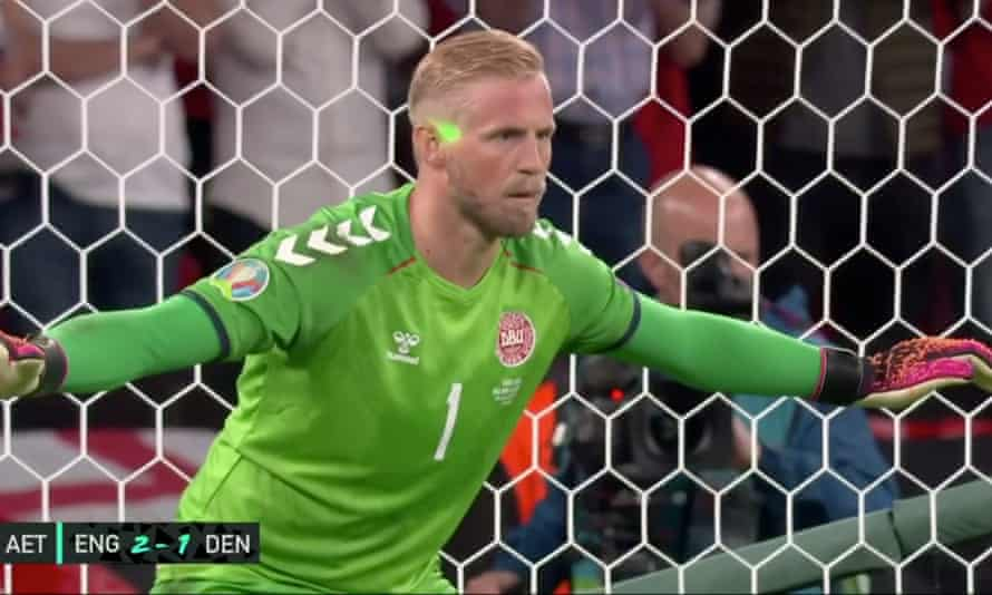 A screengrab showing a laser pointer being shone on Kasper Schmeichel's face.