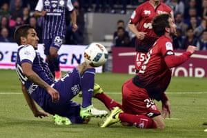 Toulouse midfielder Oscar Trejo gets stuck in against Dijon.