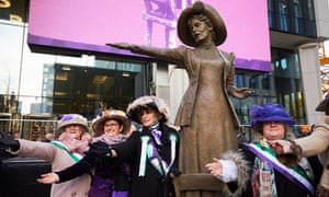 Women dressed as suffragettes pose with Our Emmeline.