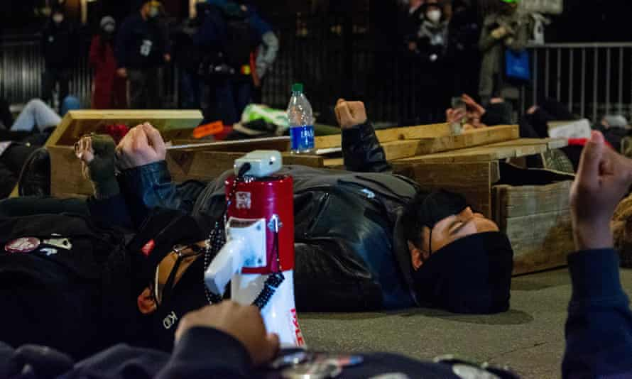 Climate activists stage a die-in near Chicago mayor Lori Lightfoot's home to protest a metal recycling plant on the Southeast Side on Thursday.