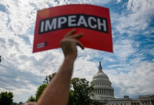 Protesters hold up letters reading 'impeach' in front of the US Capitol building during the People's Rally for Impeachment on Capitol Hill on Thursday.
