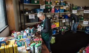 Volunteers prepare stock for food parcels at a food bank provided by the Trussell Trust