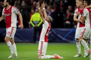 Ziyech looks to the sky as he celebrates scoring the second for Ajax.
