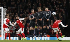 Alexis Sanchez gets his free-kick over the wall but it doesn't trouble Manuel Neuer.