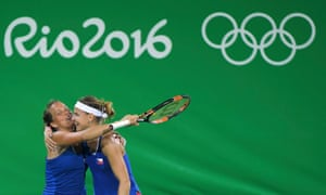 Ha, what? Lucie Safarova and Barbora Strycova celebrate their unlikely win over Serena Williams and Venus Williams.