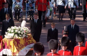 The sons of Diana, Princess of Wales, her brother and her former husband, the Prince of Wales, walk behind her coffin as the funeral procession approaches Westminster Abbey.