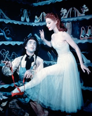 The 1948 film: Grischa Ljubov (Leonide Massine) helps Moira Shearer (Vicky Page) on with the red shoes.