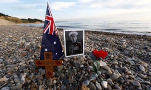 A cross and a picture of an Australian soldier who fought in the Gallipoli Campaign, are seen left by visitors near the Ariburnu Memorial at Anzac Cove in Gallipoli peninsula