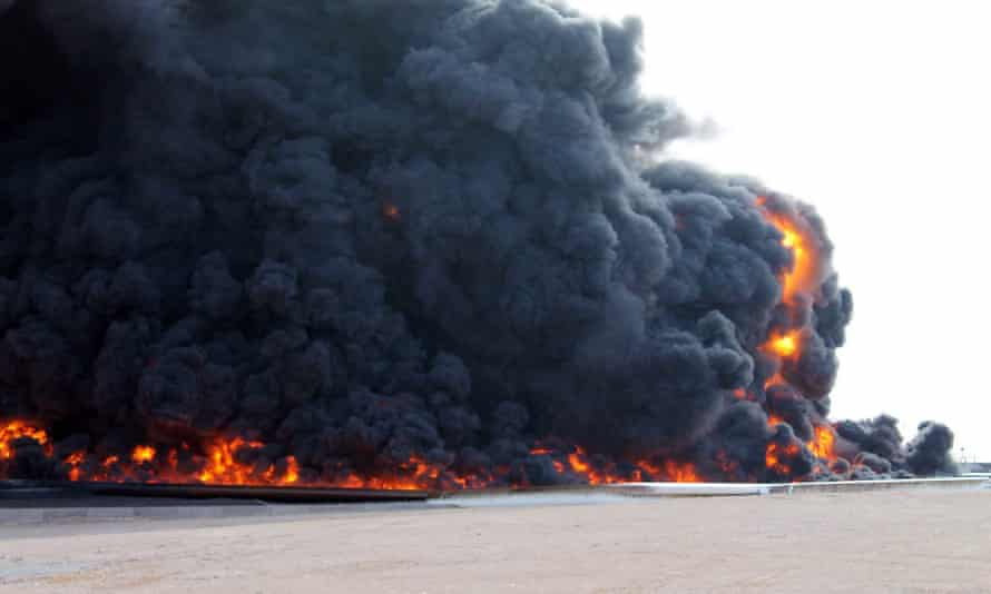 Smoke rises from an oil depot fire in al-Sidra after clashes between Isis militants and the Libyan army.