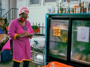 Tatiana Smith organizes the fridge outside her house in Jersey City.