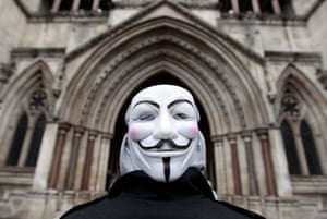 A member of Occupy London, wearing a Guy Fawkes mask, outside the High Court in London, January 18, 2012.