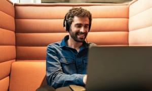Man using laptop in a modern office.
