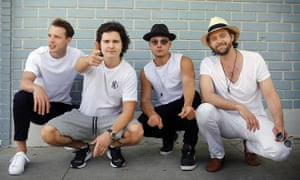 Lukas Graham, second left, and his band.