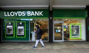 Man walks past Lloyds branch