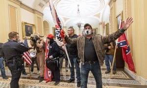 Supporters of Donald Trump push past Capitol police officers outside the Senate Chamber on Wednesday.