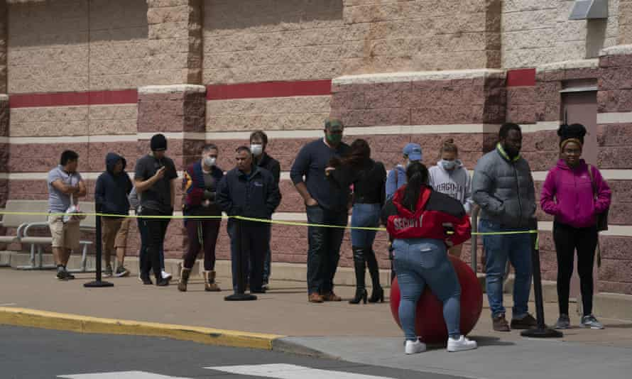 Customers line up to enter a Target store in Falls Church, Virginia, on 20 April.