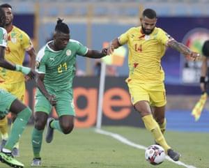 Senegal's Lamine Gassama and Benin's Cebio Soukou fight for the ball.