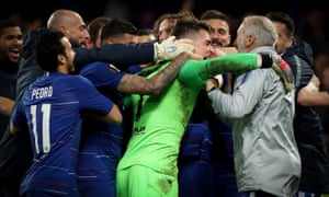 Kepa Arrizabalaga is mobbed after his saves helped Chelsea reach the Europa League final.