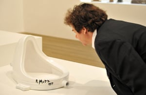 A visitor looks Marcel Duchamp's Fountain, 1917, at Tate Modern, London, in 2008.