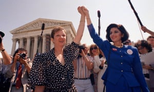 Norma McCorvey, left, and her attorney Gloria Allred hold hands as they leave the supreme court building. She later became a fierce opponent of abortion rights.